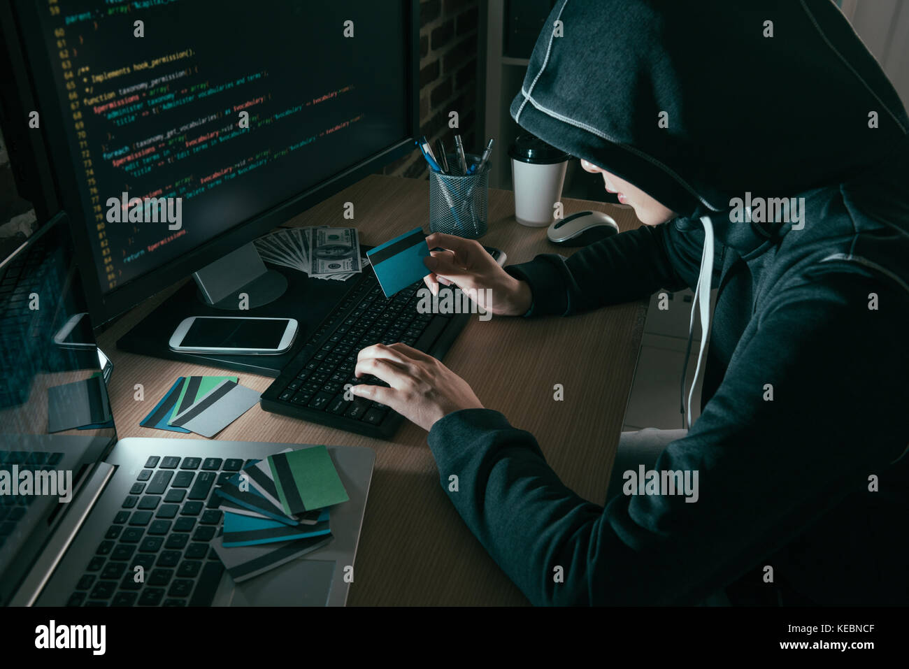 high angle view photo of hacker using computer online system stolen brushing credit card. Stock Photo