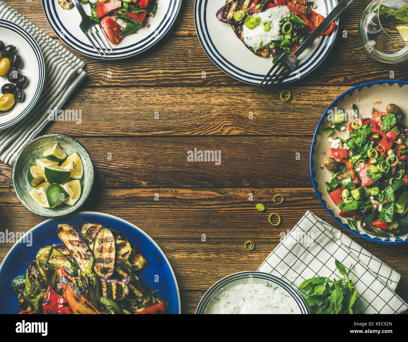 Flat-lay of healthy dinner table setting with vegetarian snacks - Stock Image