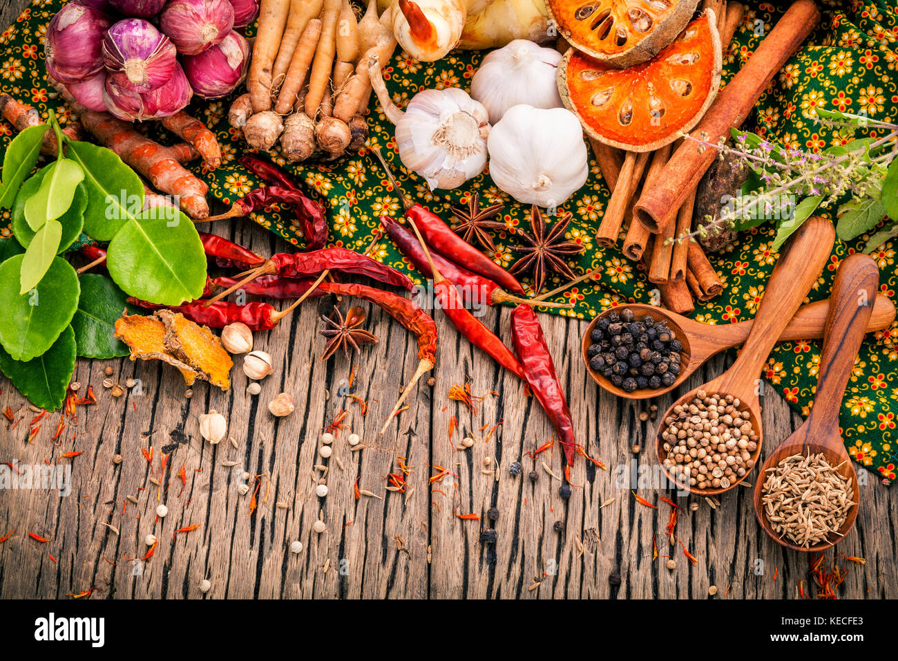 Assortment of Thai food Cooking ingredients .Red curry paste ingredients of thai popular food on rustic wooden background. - Stock Image