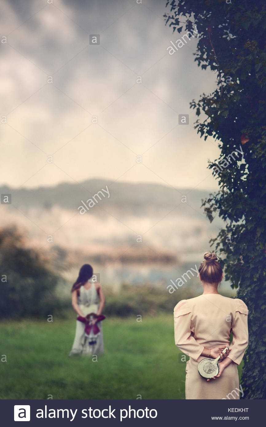 My naive memories. Girl looking back on her past as a naive girl - Stock Image