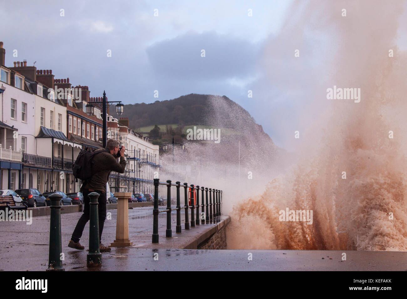 Sidmouth, UK. 21st Oct 2017. UK Weather. People take photographs on the Esplanade as Storm Brian hits Sidmouth, Stock Photo
