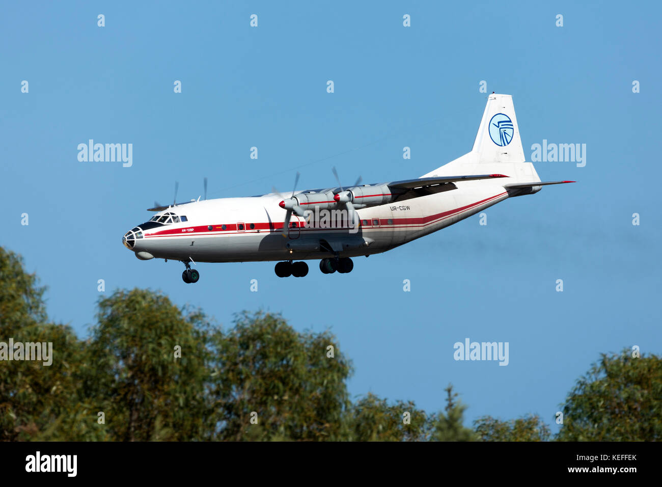 Ukraine Air Alliance Antonov An-12BP [UR-CGW] on short finals runway 31. - Stock Image