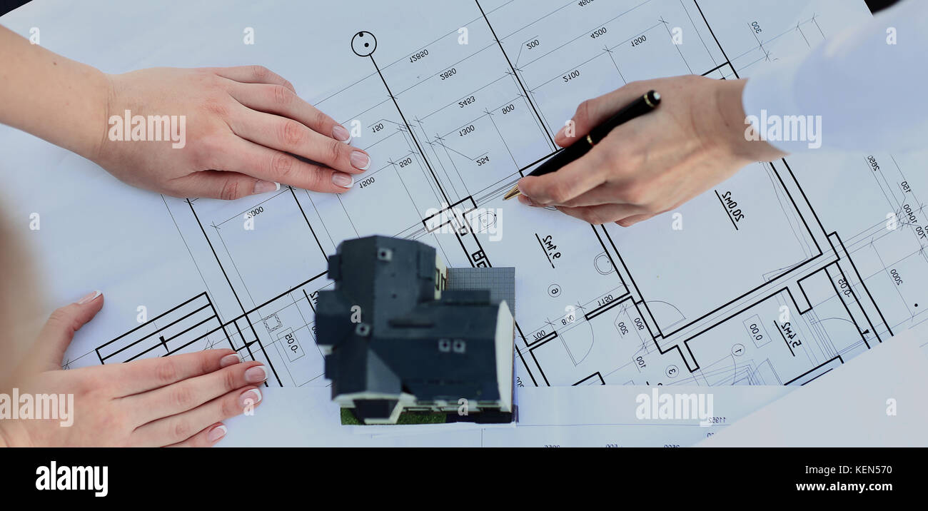 architects model house with plan and blueprints - Stock Image