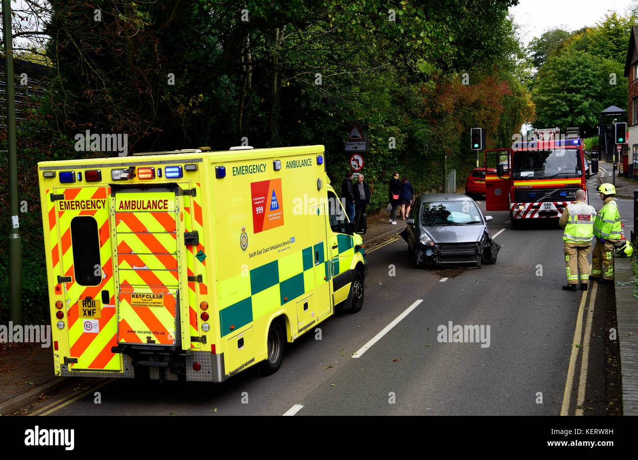 Emergency services (ambulance and fire engine) at the scene of a road traffic accident, Haslemere, Surrey, UK. Saturday - Stock Image