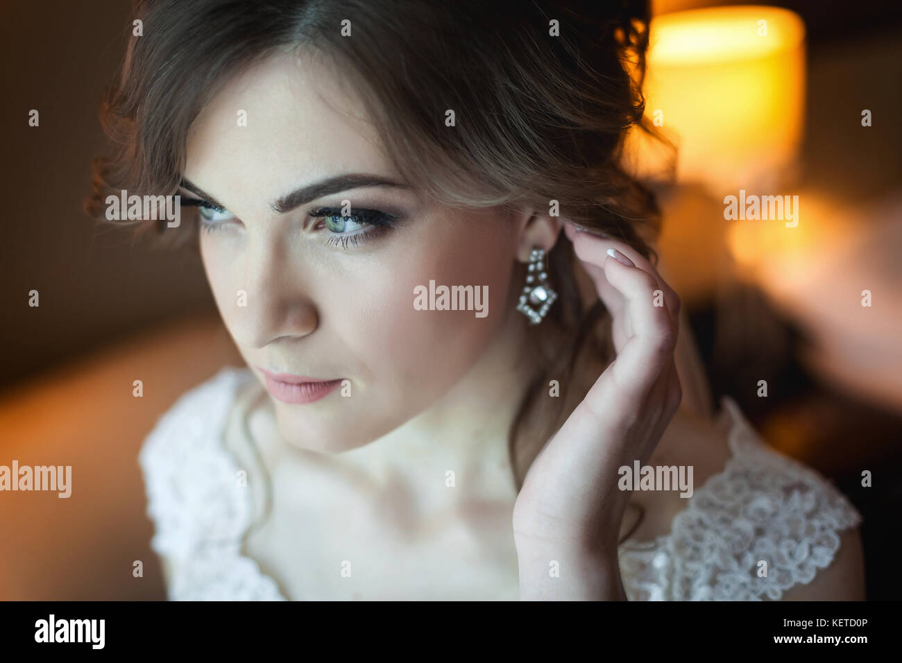 Young bride getting ready for the wedding - Stock Image