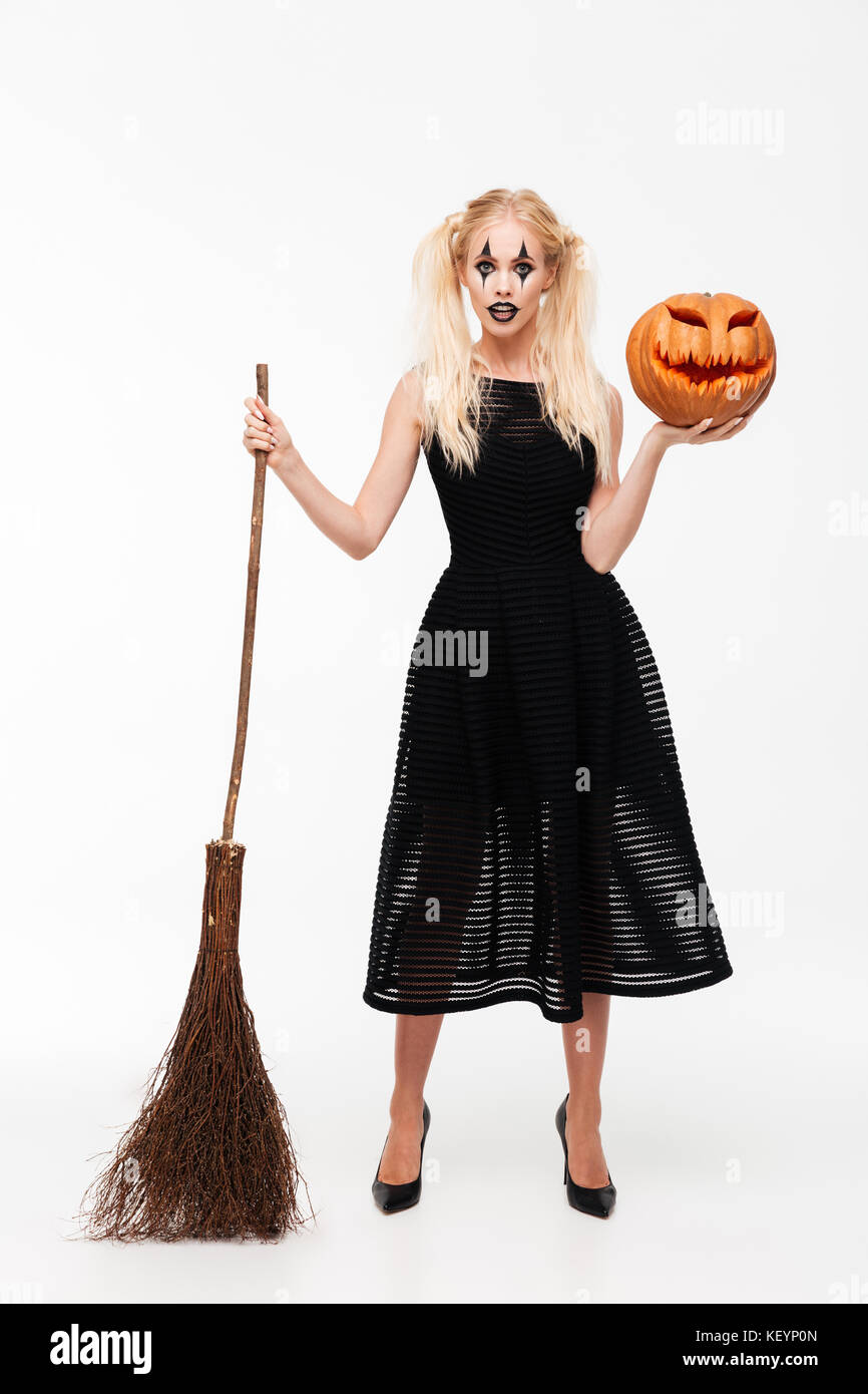 full length portrait of a pretty blonde woman dressed in witch stock
