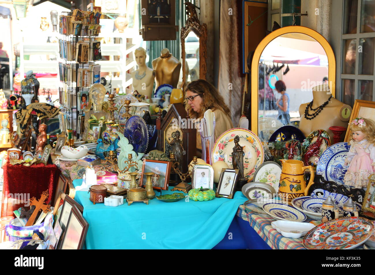 Traders offer all kind of goods at the popular Market of the Thieves in Lisbon Portugal Stock Photo