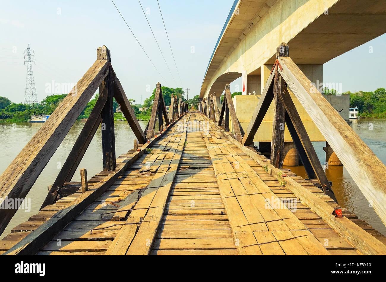 Mato Grosso do Sul, Brazil - September 15, 2017: Old wooden bridge above Rio Miranda river preserved as a municipal - Stock Image