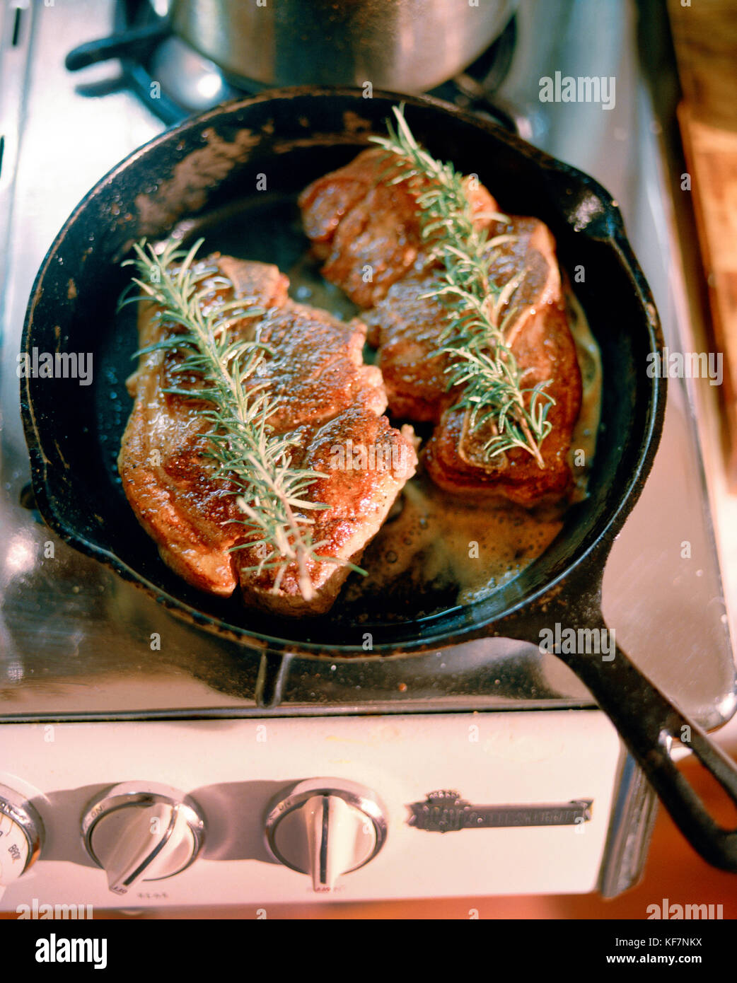 USA, California, Sonoma, pork being seared in a cast-iron pan, Brick House Bungalows - Stock Image