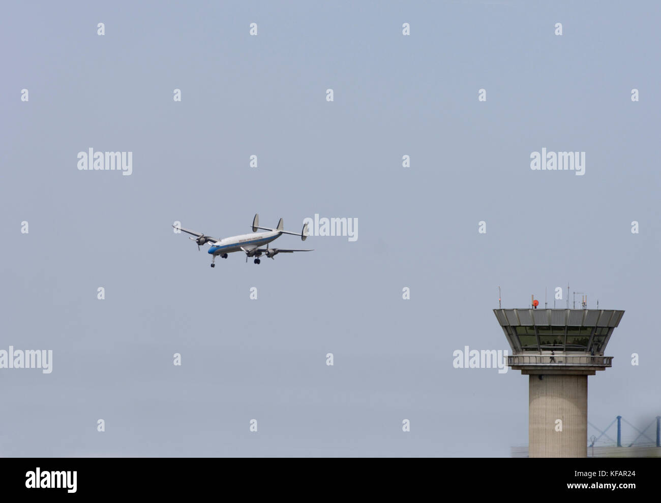 the air tower control-tower with the Breiting Super Connie, Switzerland Lockheed L-1049 Super Constellation C-121C - Stock Image