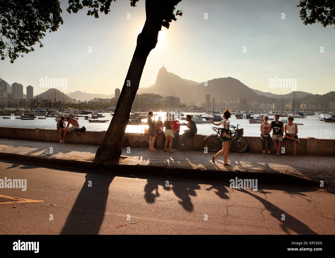BRAZIL, Rio de Janiero, Bar Urca, people sit on a Sea Wall on the Atlantic Ocean Stock Photo