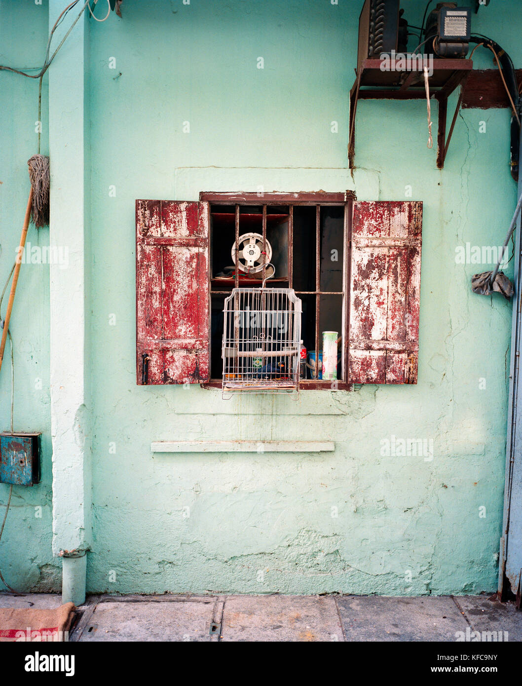 CHINA, Macau, Taipa, Asia, Birdcage hanging in front of house window - Stock Image