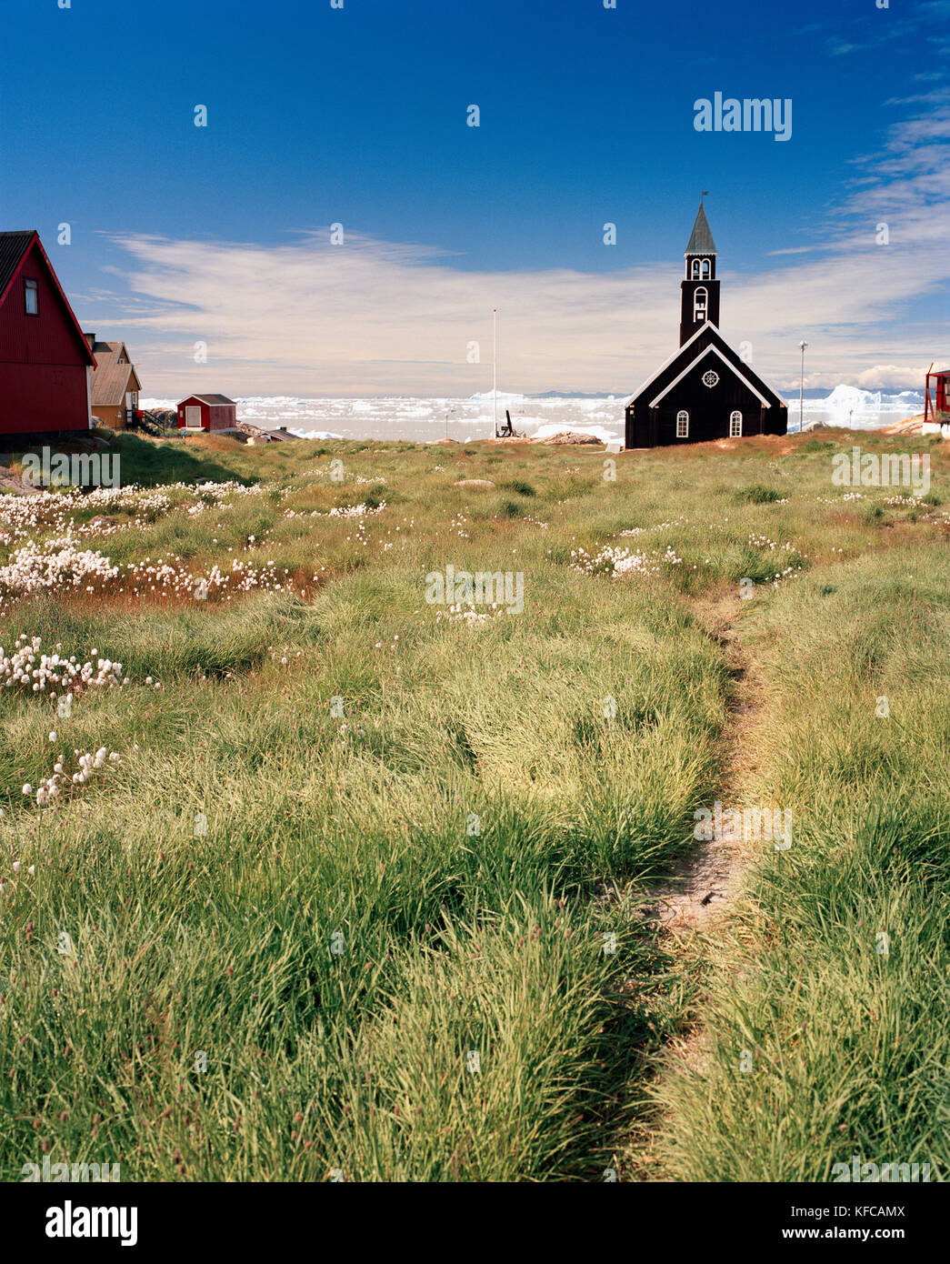 GREENLAND, Ilulissat, Disco Bay, exterior of church with field - Stock Image