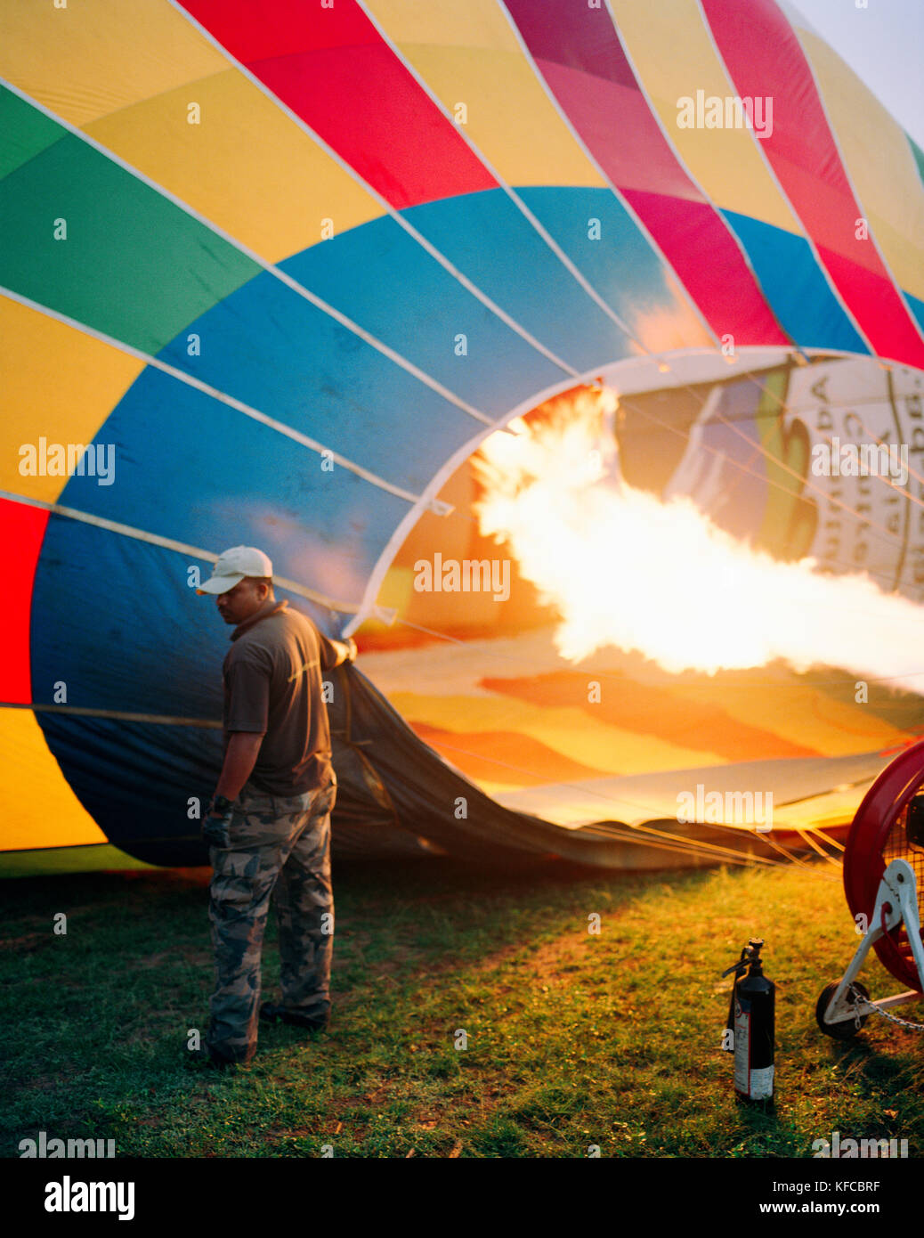 SRI LANKA, Asia, man operating a flame to fill a hot-air balloon - Stock Image
