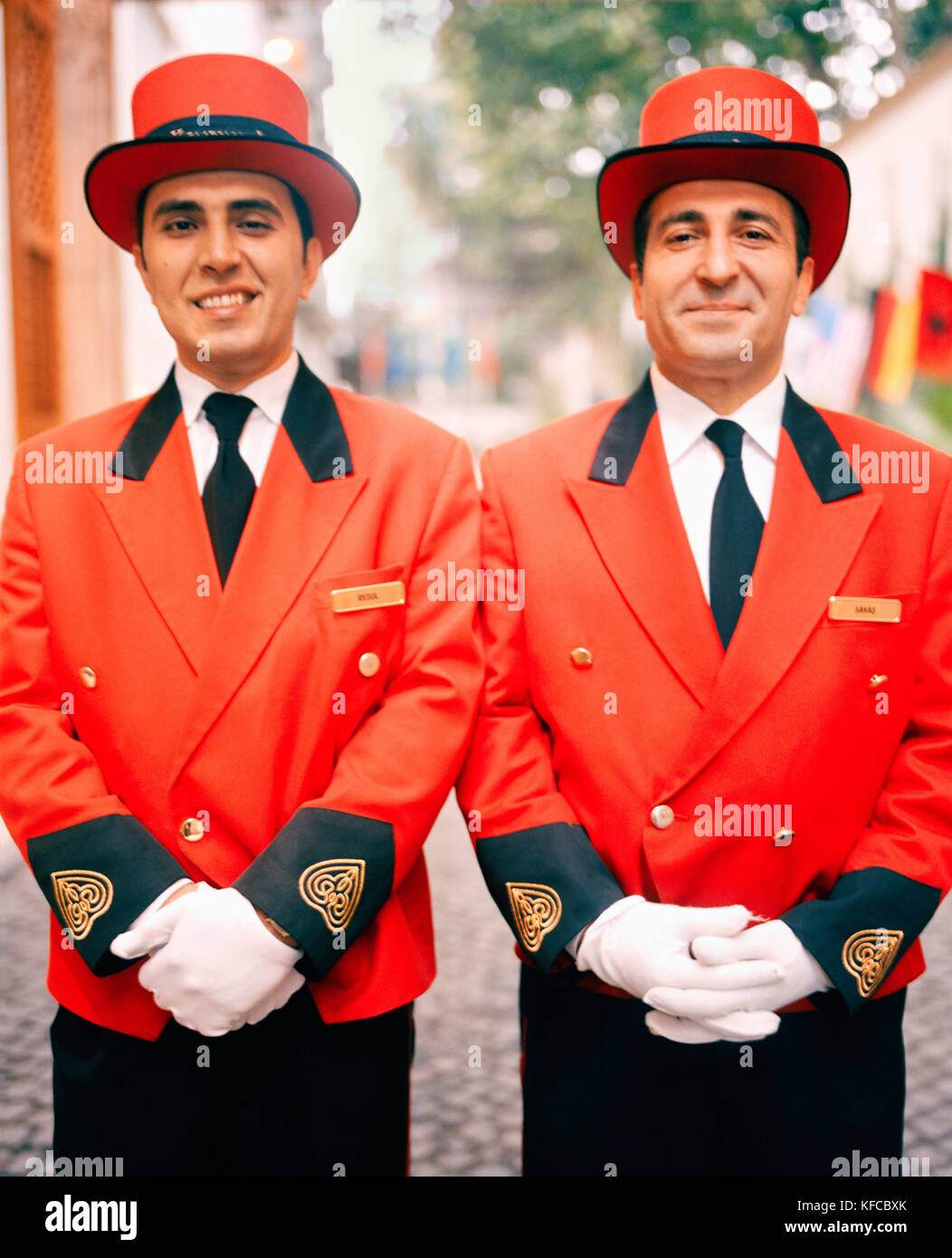 TURKEY, Istanbul, portrait of two bellboys standing side by side at the Hotel Kempinski. - Stock Image