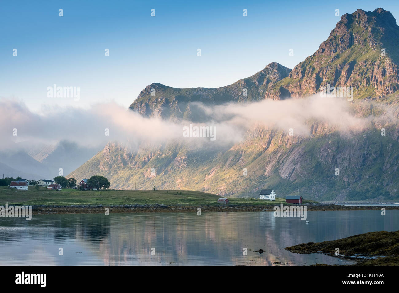 Scenic view with idyllic house and mountains at summer evening in Lofoten, Norway - Stock Image