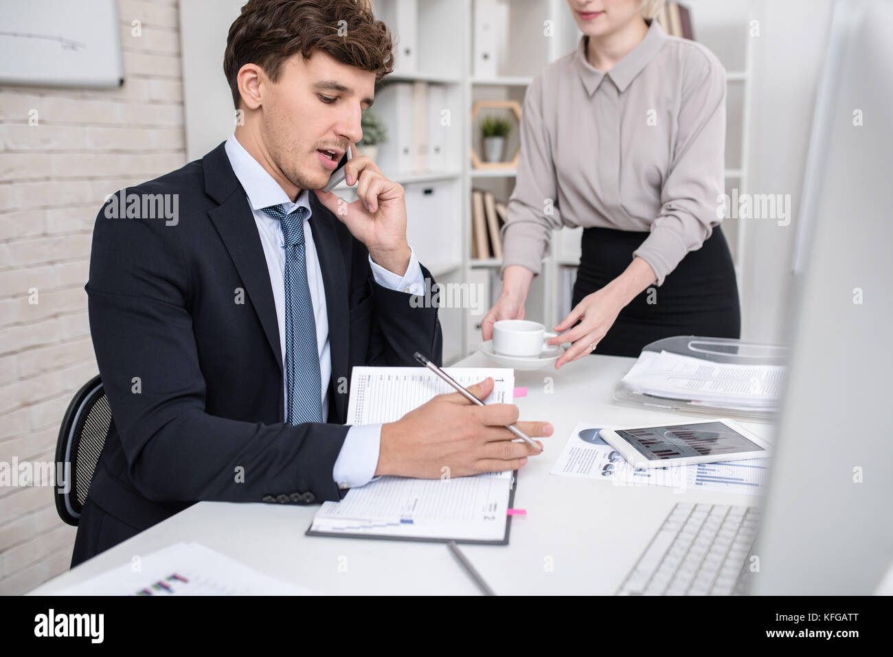 Business Executive Busy Working in Office Stock Photo