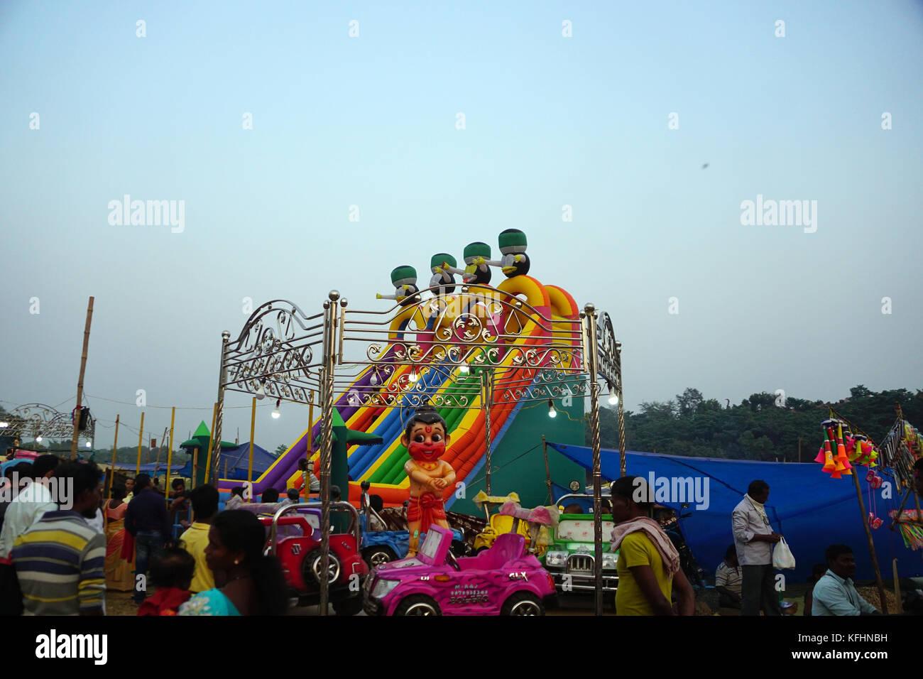 Chaibasa, Jharkhand, India, 29th October 2017: The Ferris wheel, dragon-coaster ride of amusement Park in Gaushala - Stock Image
