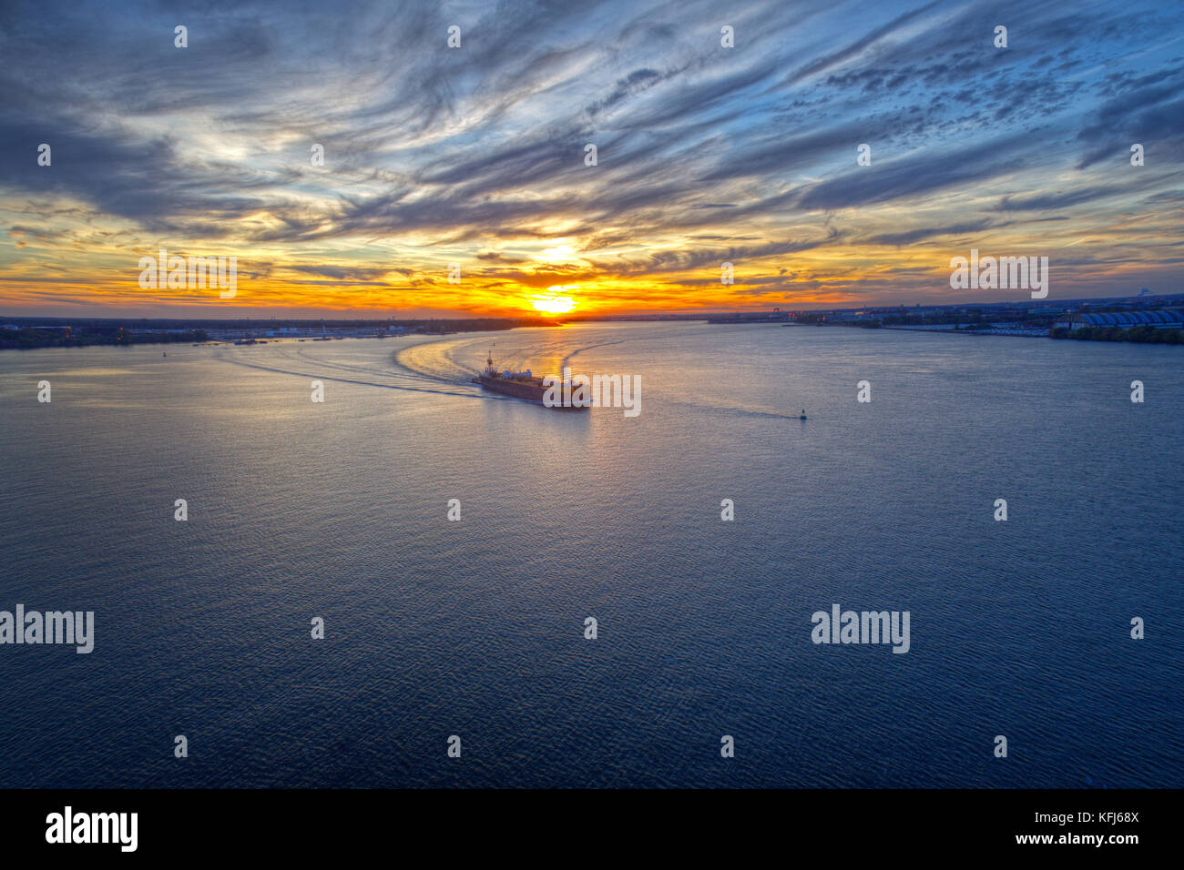 Aerial View of Sunset over Water with Cargo Ship - Stock Image