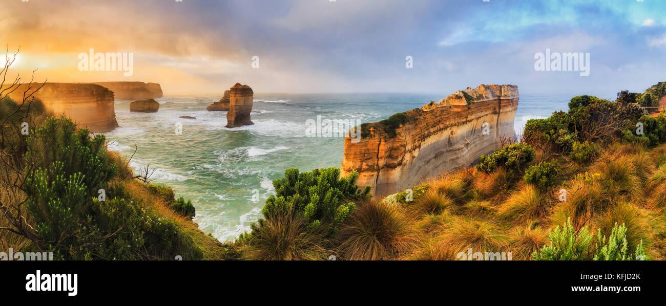 Razorblade cut off limestone rock of Great Ocean road twelve apostles marine park in Victoria. Colourful sunrise - Stock Image