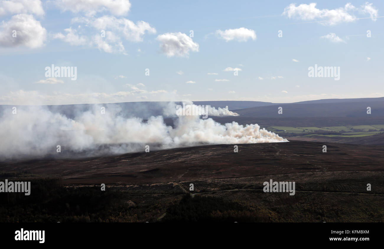 aerial view of stubble burning smoke on the North Yorkshire Moors, UK - Stock Image