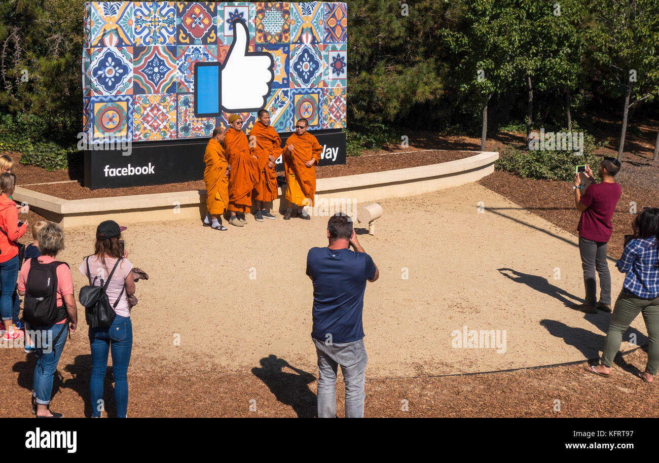 https://c7.alamy.com/comp/KFRT97/facebook-headquartersthumbs-up-sign-with-buddhist-monks-and-other-KFRT97.jpg