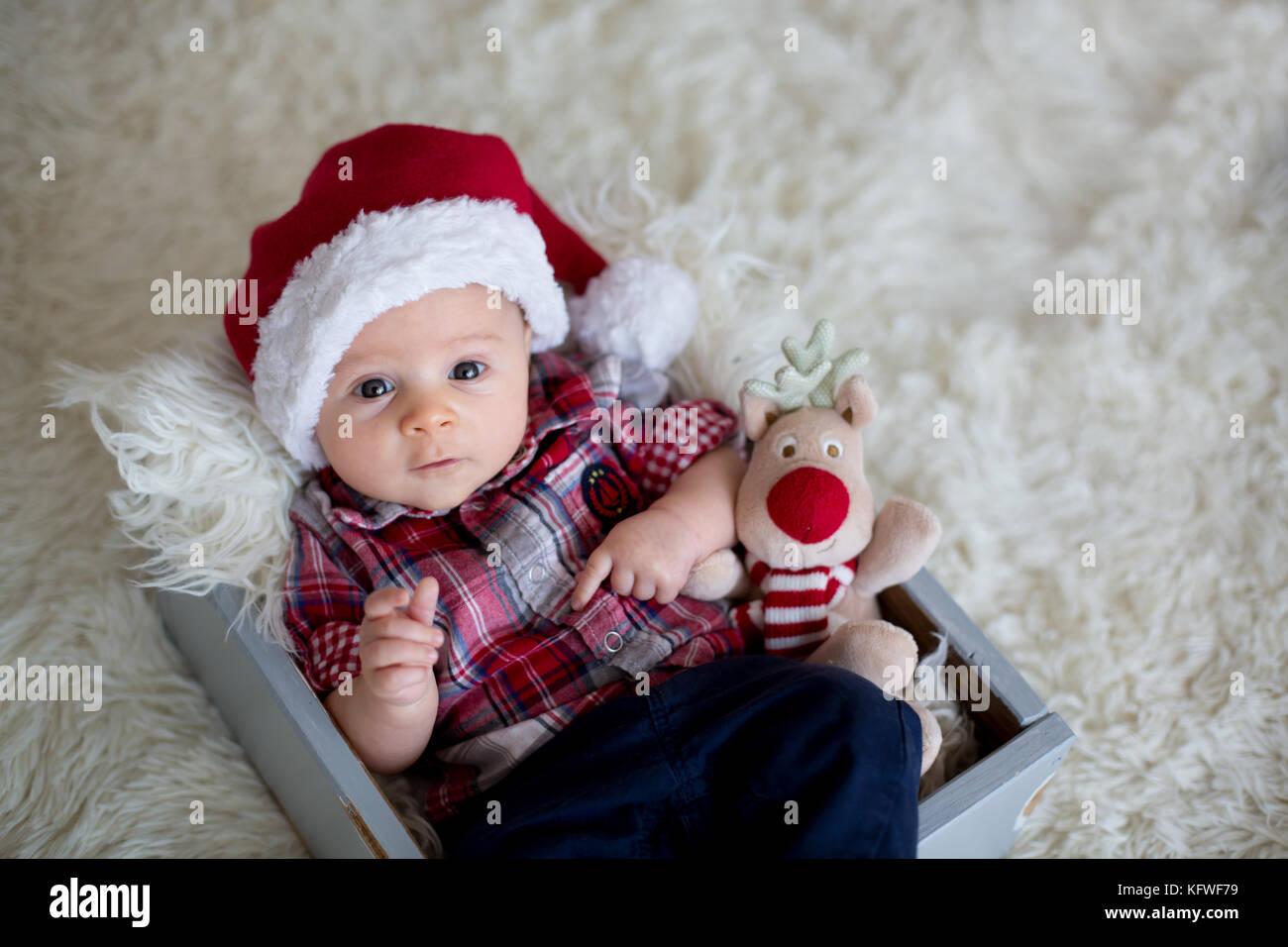 0737da2a544a Christmas portrait of cute little newborn baby boy