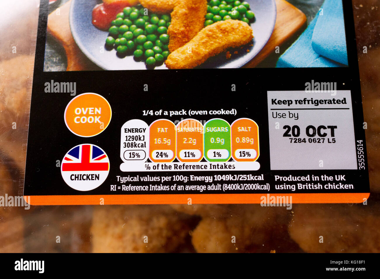 Close up of food label nutritional information & use by date on a pack of Sainsbury's chicken goujons - Stock Image