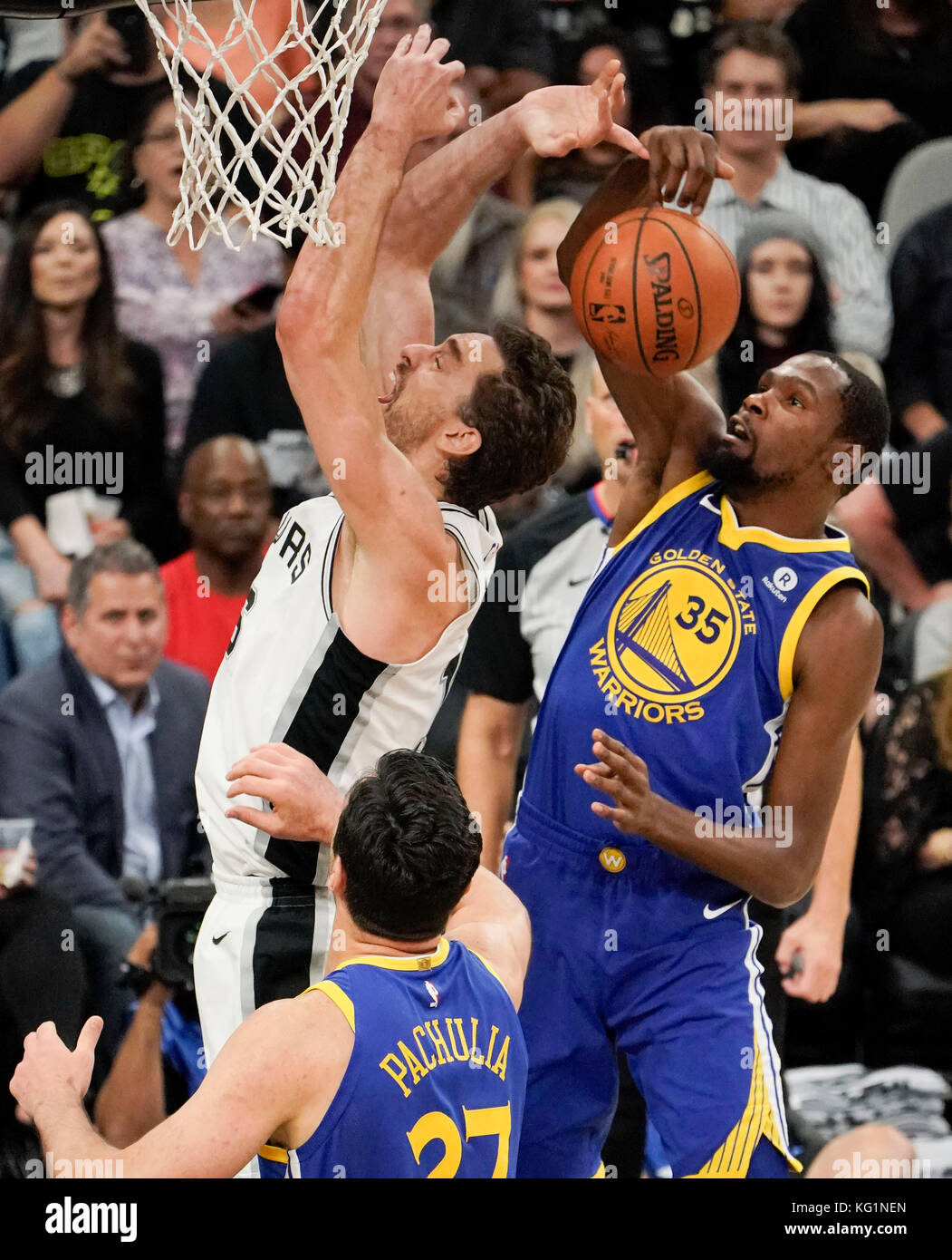 60d93944216 Golden State Warriors players Kevin Durant (R) and Zaza Pachulia (down)  defend San Antonio Spurs center Pau Gasol during an NBA basketball game  between ...
