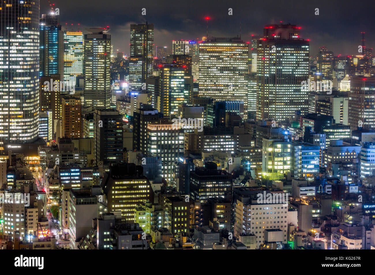 Downtown city buildings at night, Tokyo, Japan, Asia - Stock Image