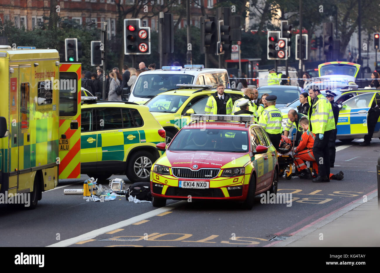 Road Traffic Accident Central London Motorcyclist injured and being treated by medics - Stock Image