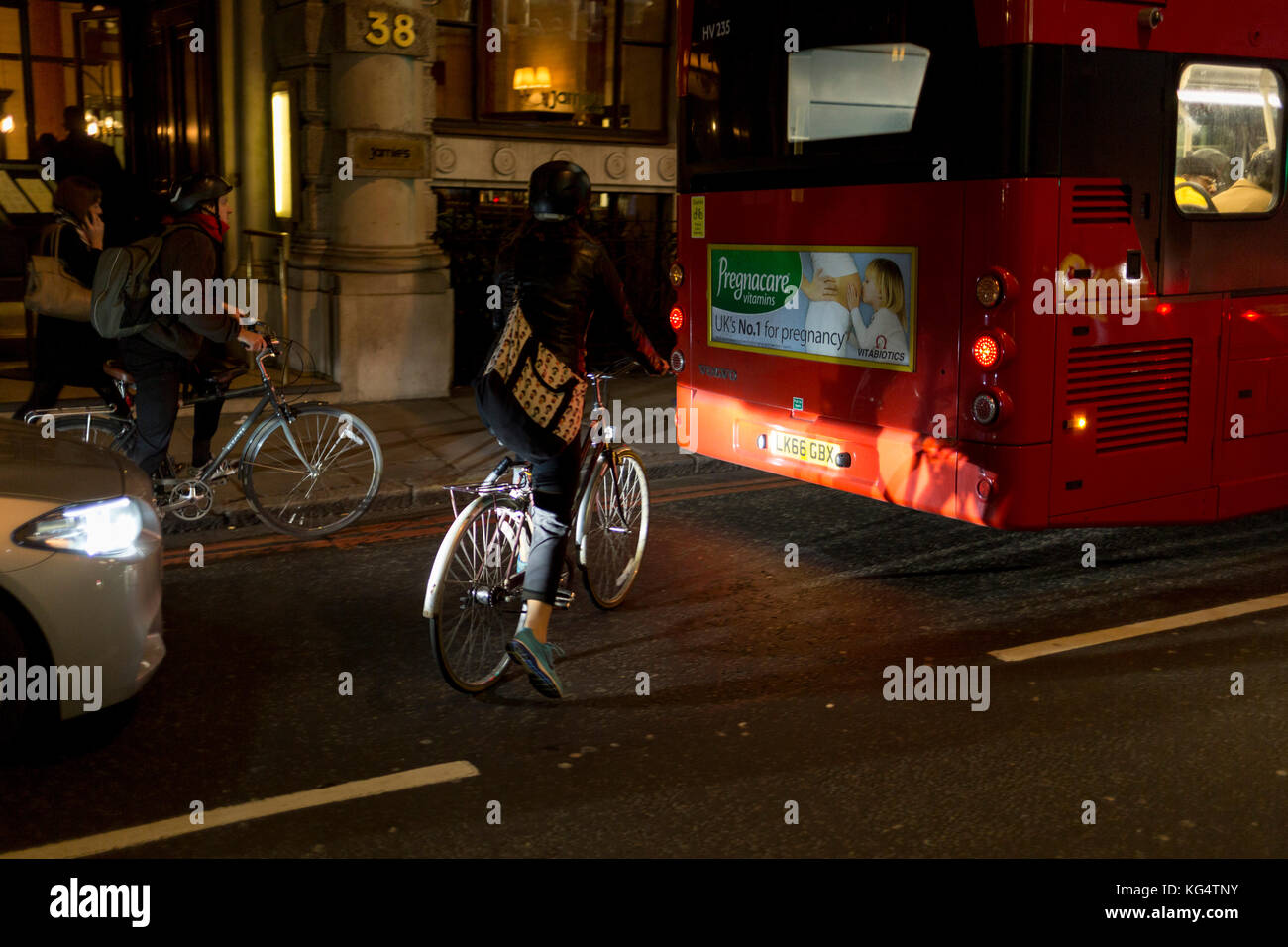 a-waiting-cyclist-is-illuminated-by-car-