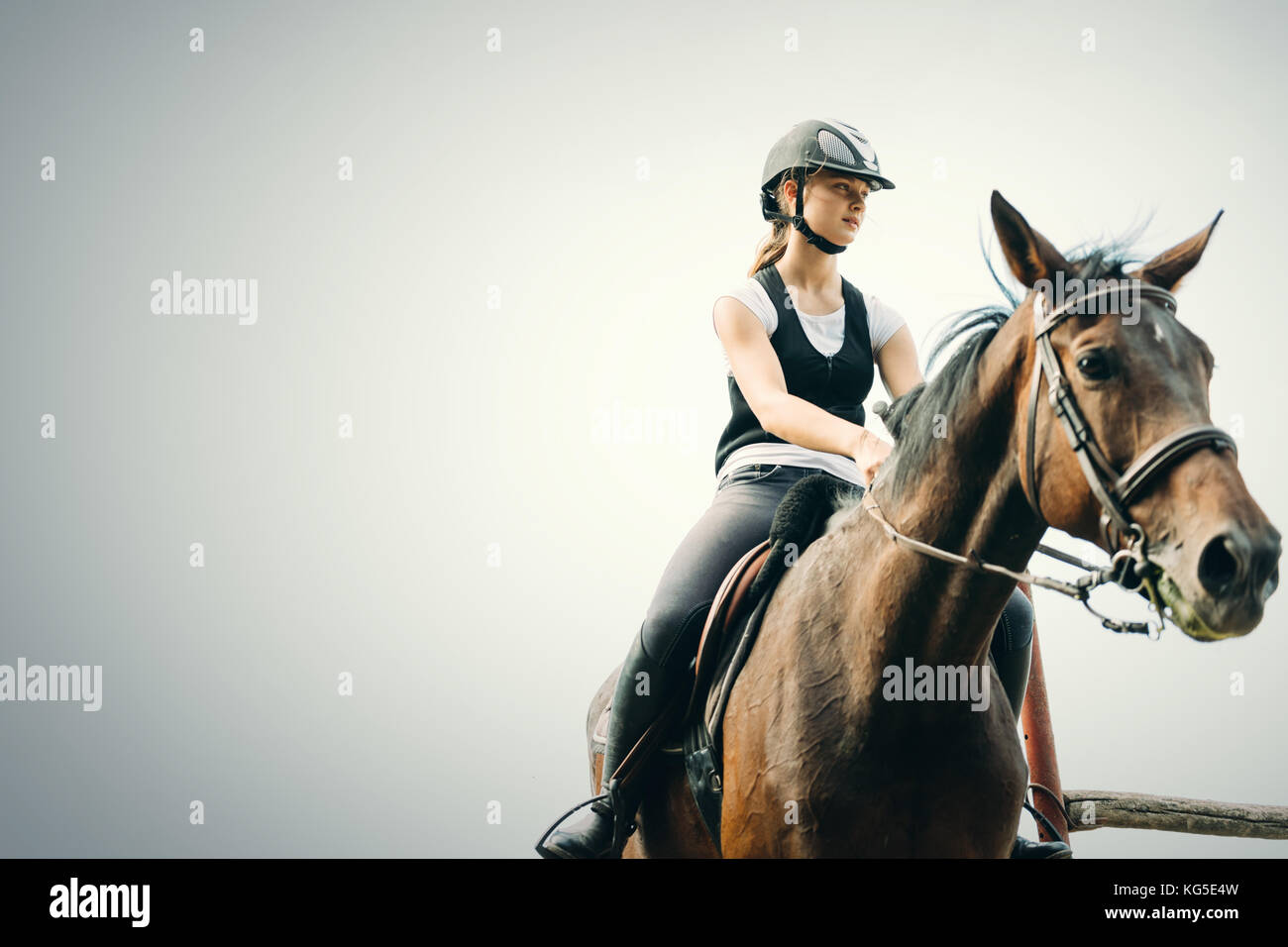 Picture of young girl riding her horse - Stock Image