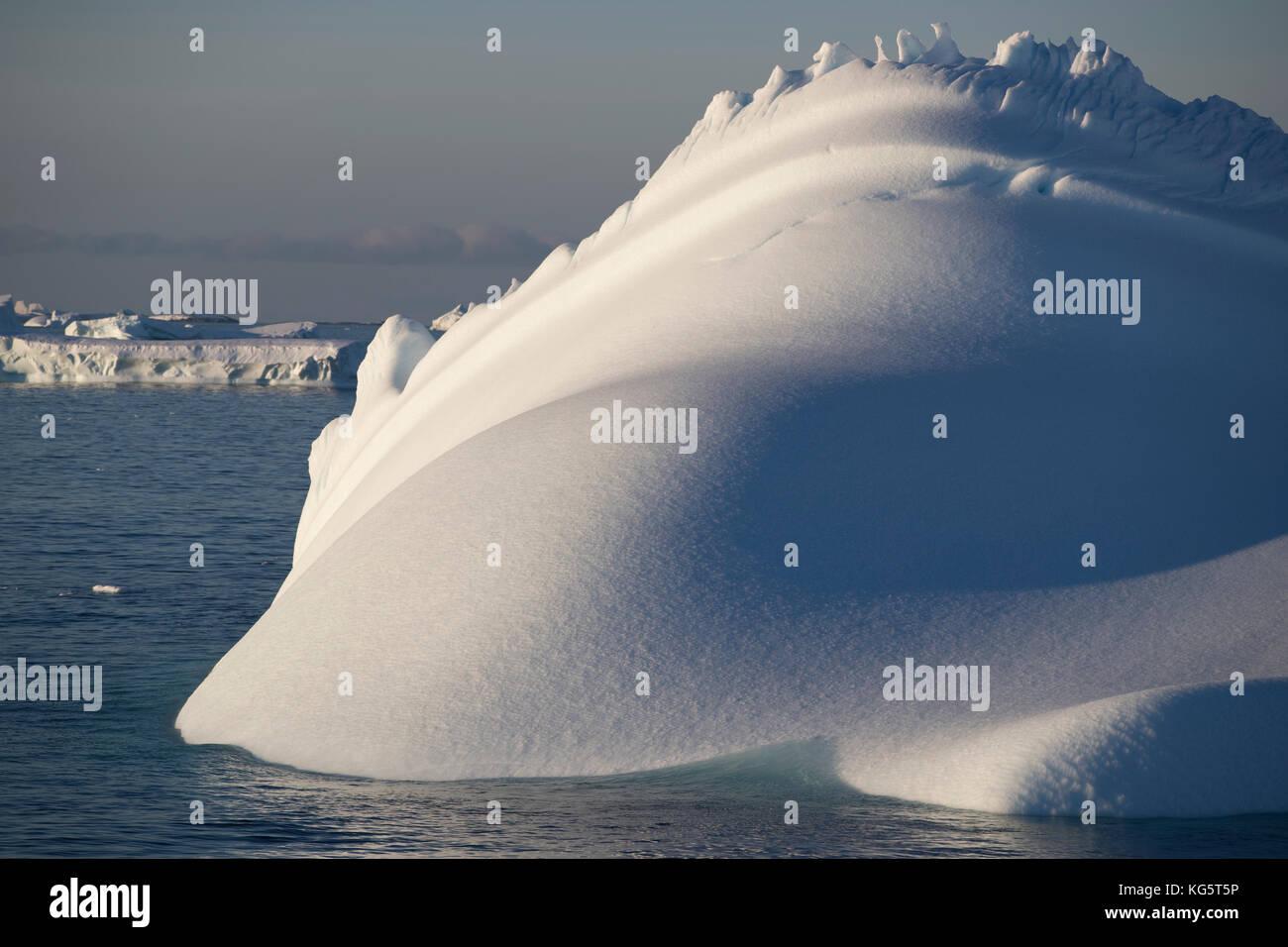 Sculptural looking iceberg, Antarctica - Stock Image
