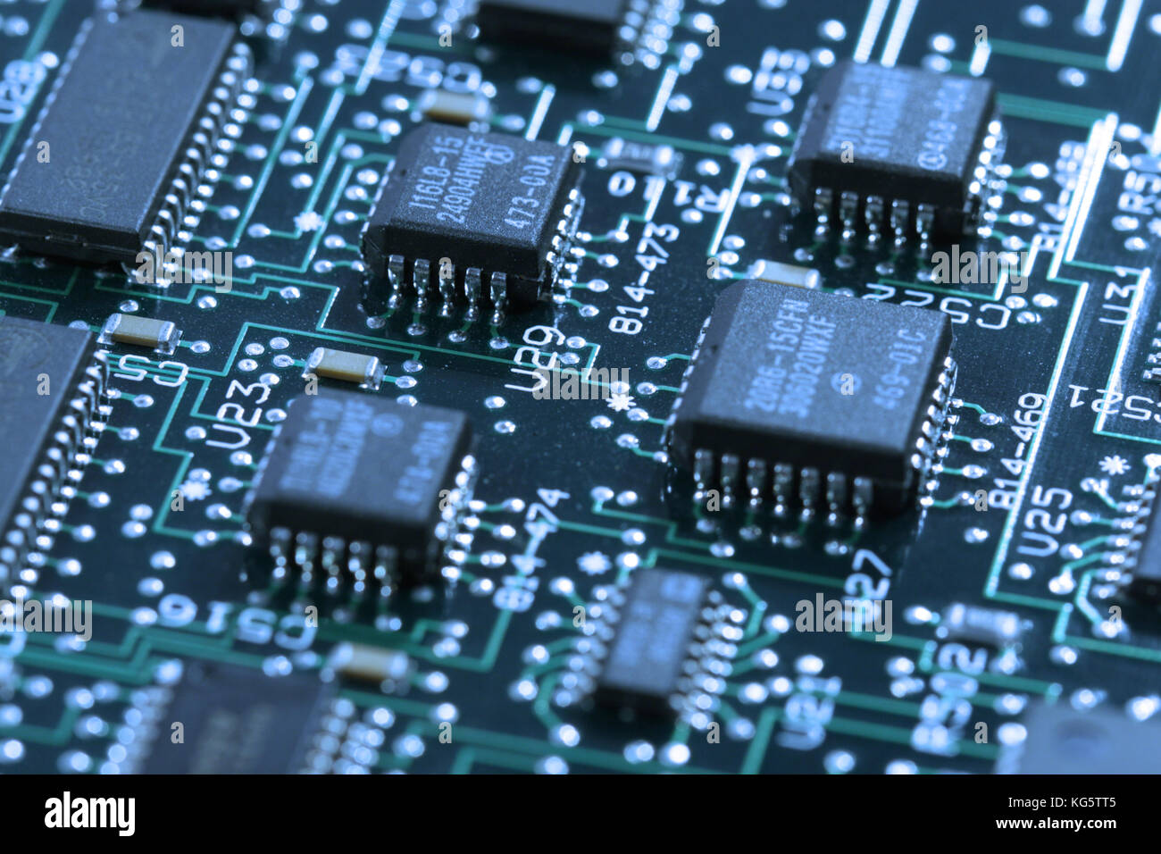 computer mainboard - dual inline modules, surface mounted devices with green, red, blue light - macro shot - Stock Image