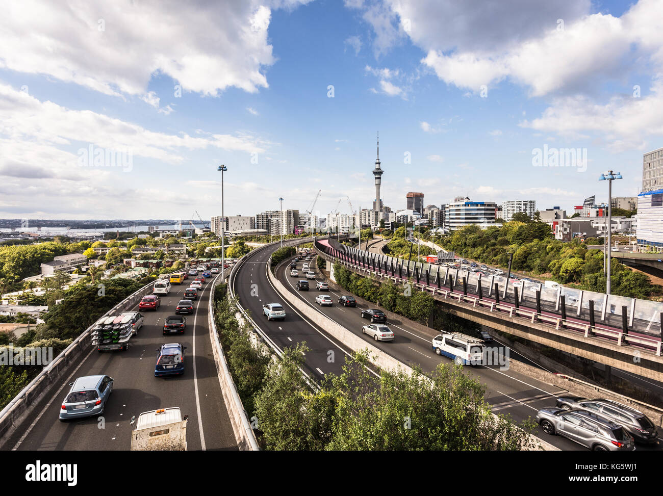 Heavy traffic along the spaghetti junction of various highways in Auckland, New Zealand largest city on a sunny Stock Photo