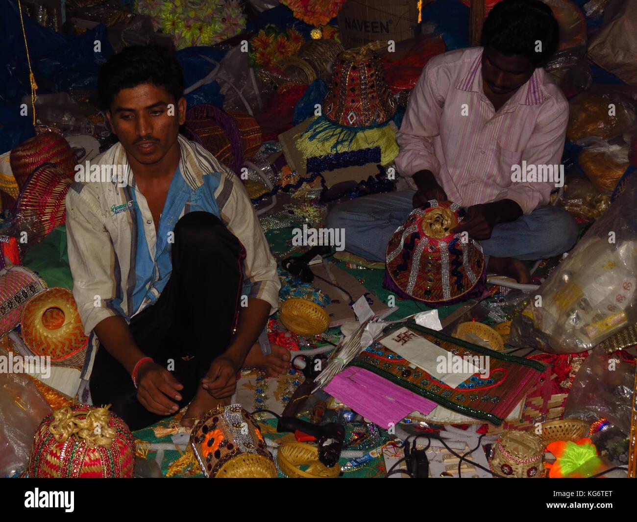 Indian craftsmen make traditional Diwali lanterns in their factory in India. - Stock Image