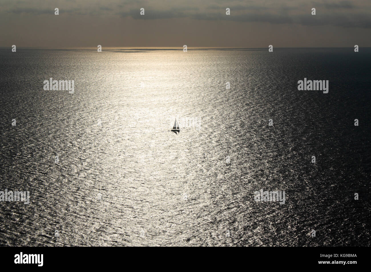 solitary-sailing-boat-caught-in-the-suns