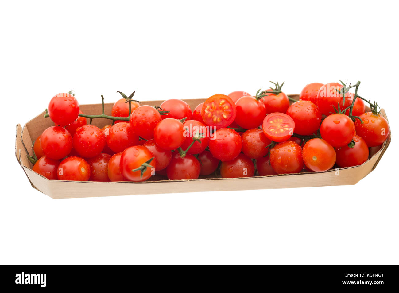 Fresh organic red cocktail tomatoes in a tray, isolated on white background. - Stock Image