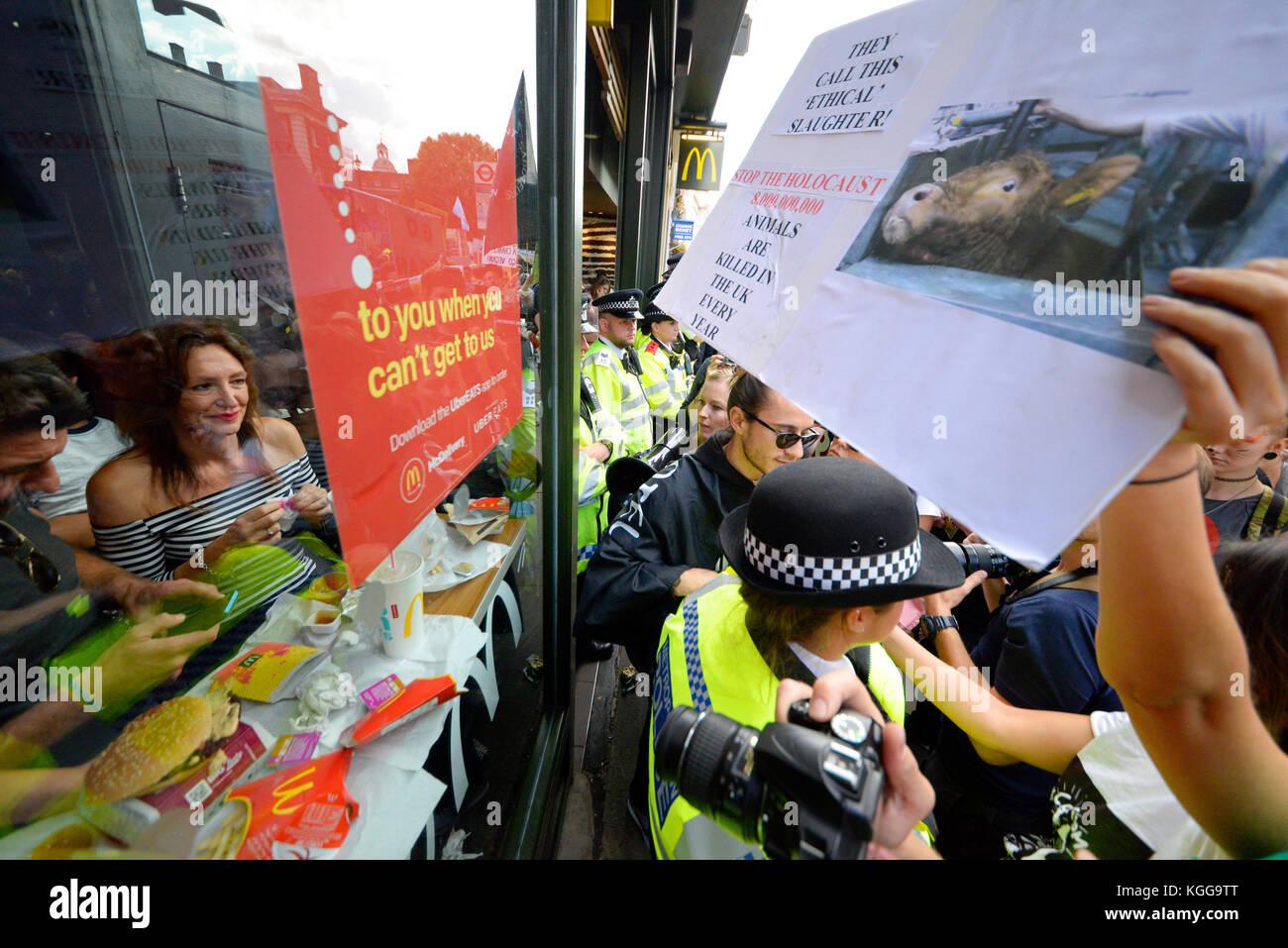 vegan-activists-besieging-a-mcdonalds-restaurant-in-whitehall-london-KGG9TT.jpg