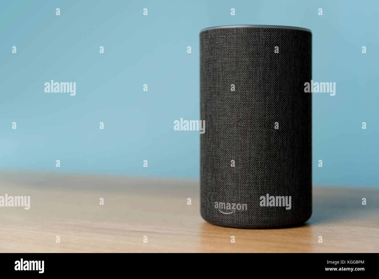 The 2017 release of a charcoal Amazon Echo (2nd generation) smart speaker and personal assistant Alexa shot against Stock Photo
