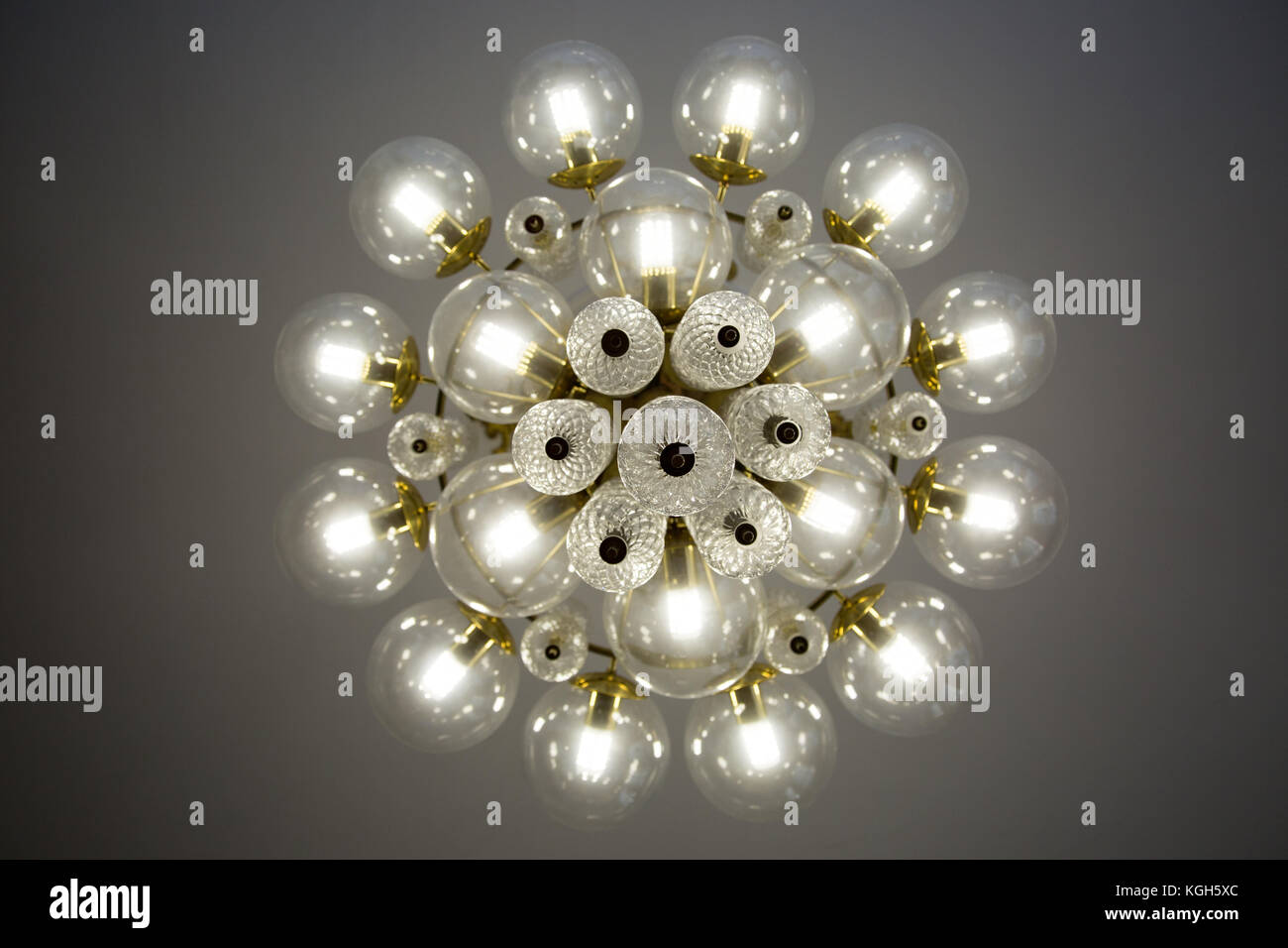 Crystal glass chandelier view from bottom round shape round glass crystal glass chandelier view from bottom round shape round glass bulb covers lit energy efficient light bulbs arubaitofo Gallery