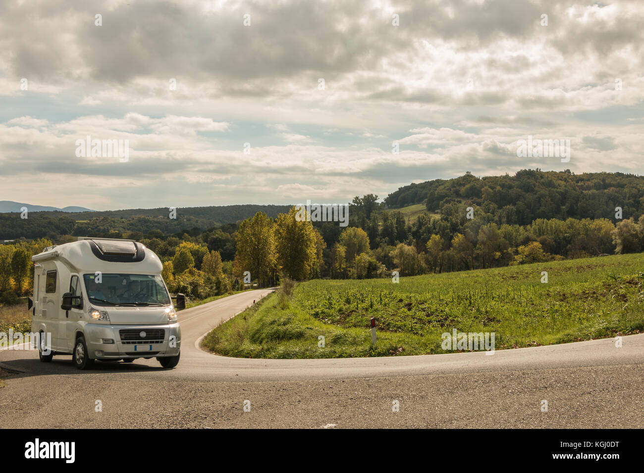 A campervan travel trip to Tuscany Italy Driving Camping road Florence Siena Lucca - Stock Image