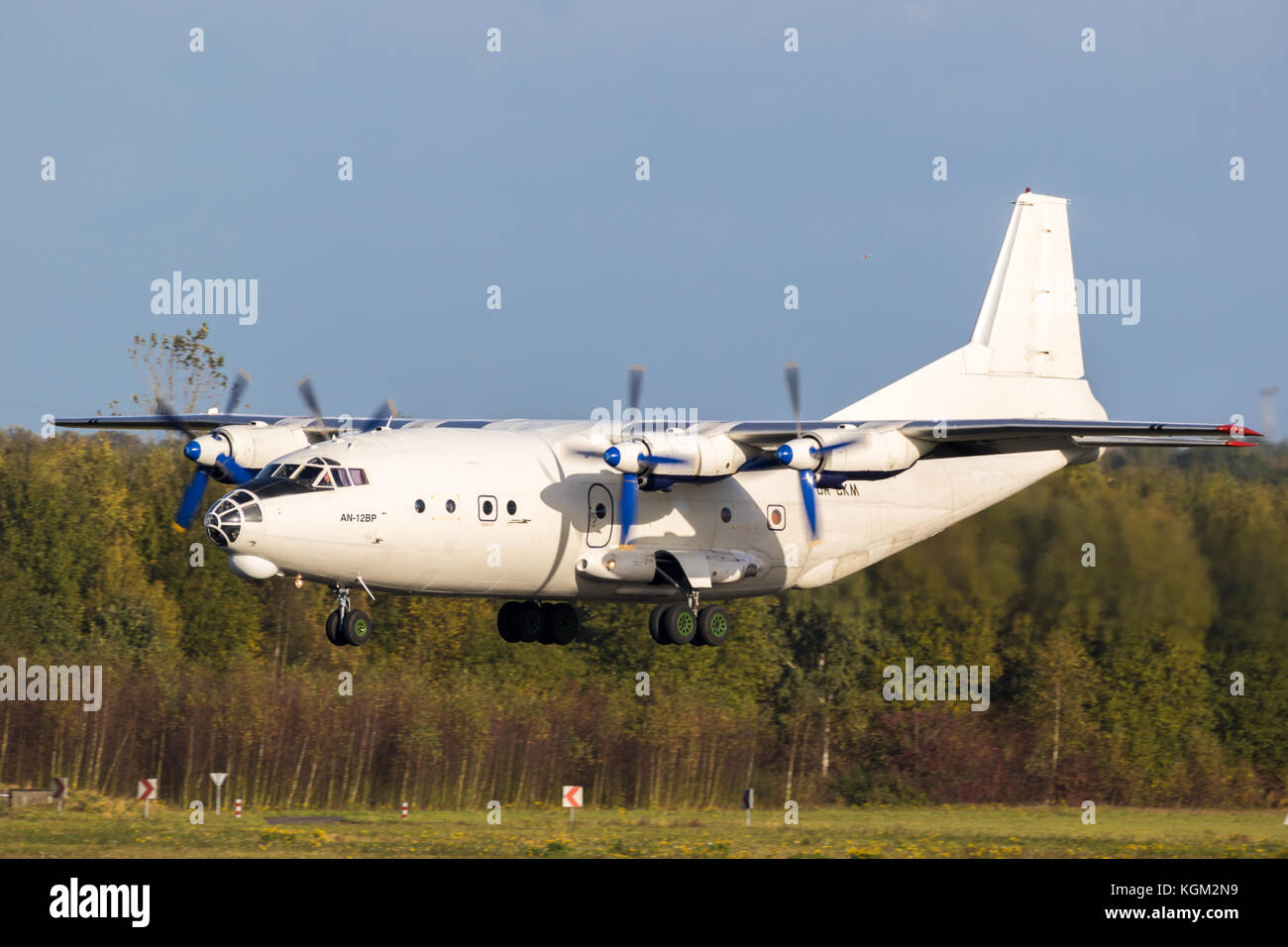 EINDHOVEN, THE NETHERLANDS - OCT 27, 2017: White Antonov An-12 cargo plane landing on Eindhoven airport - Stock Image