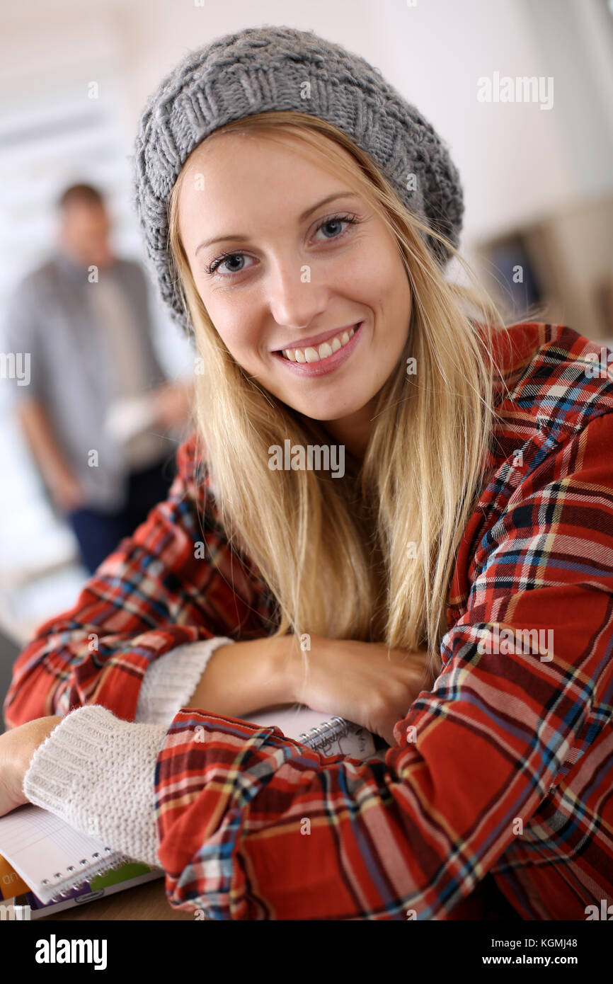 Trendy student girl sitting in class - Stock Image