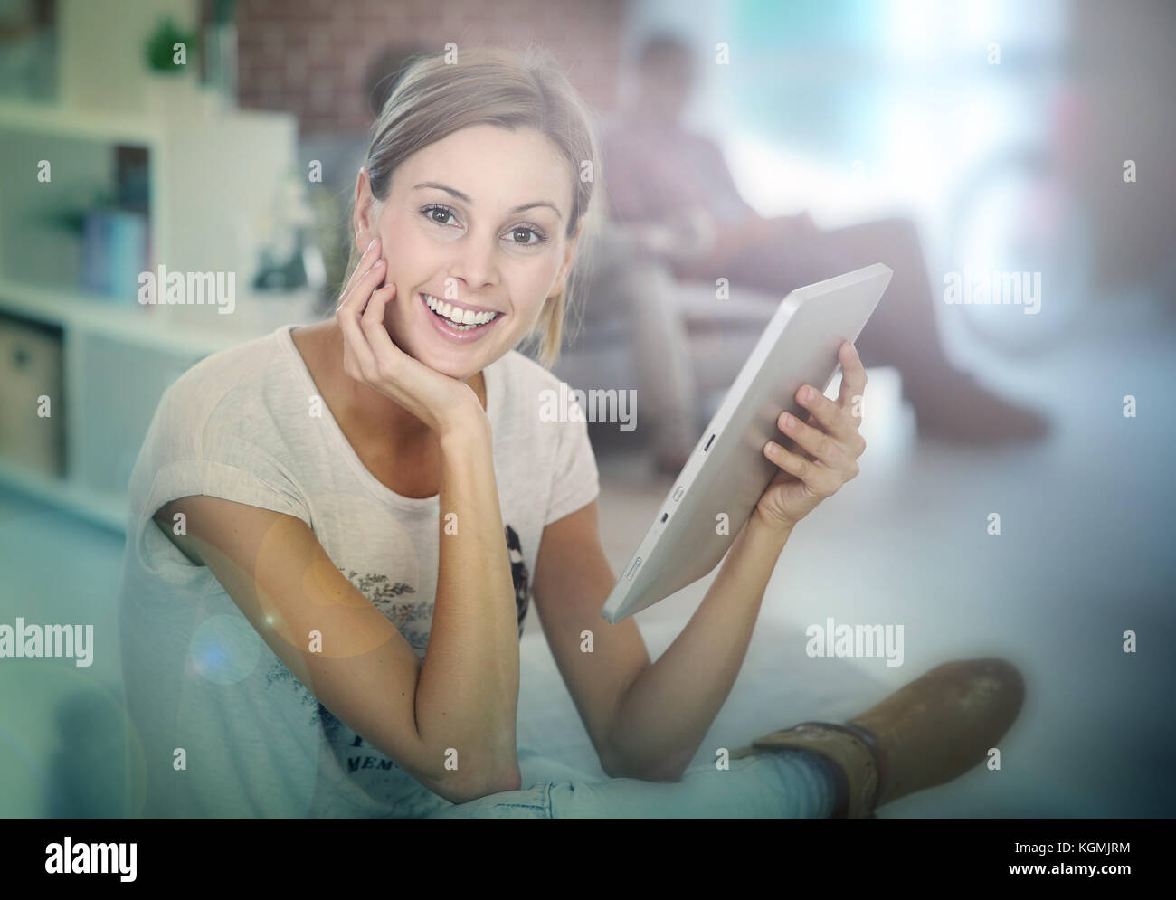 Young woman using digital tablet - Stock Image