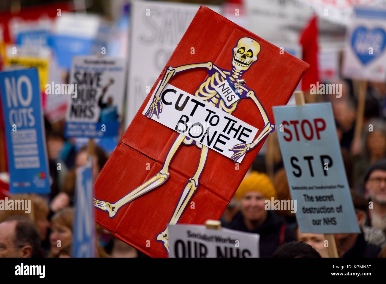 cut-to-the-bone-placard-during-our-nhs-protest-demonstration-rally-KGMN8T.jpg