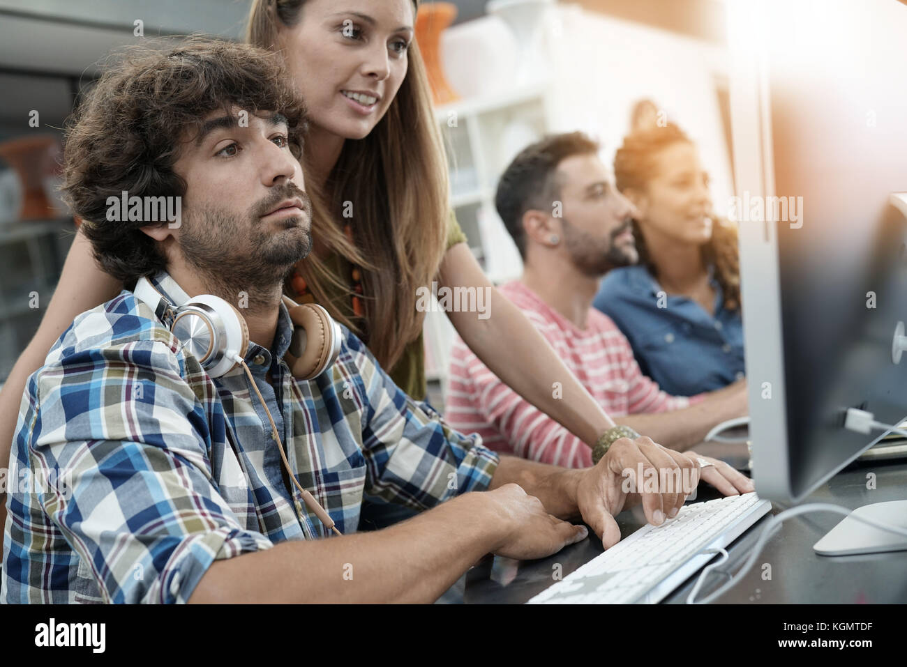 Co-workers in office working on project in desktop - Stock Image
