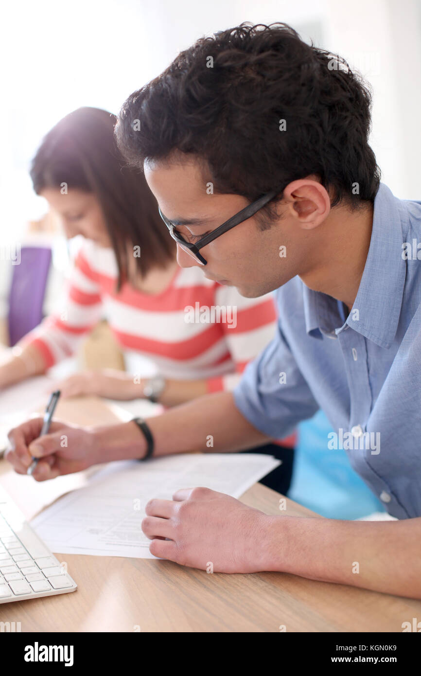 Student filling application form for business school - Stock Image