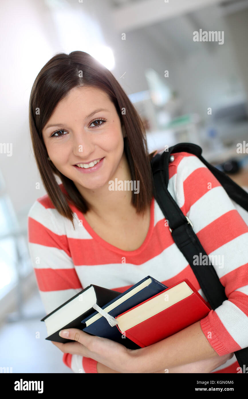Portrait of cheerful student girl - Stock Image